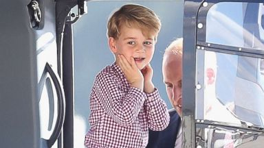 PHOTO: Prince George reacts as the Royals view helicopter models before departing from Hamburg airport on the last day of their official visit to Poland and Germany, July 21, 2017, in Hamburg, Germany.