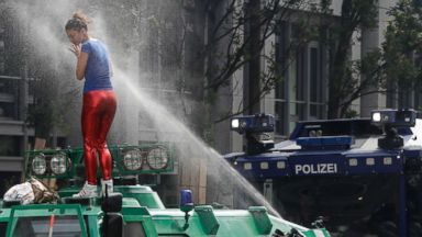 PHOTO: A woman is pepper-sprayed by police after she climbed an armored police vehicle on the first day of the G-20 summit in Hamburg, Germany, July 7, 2017.