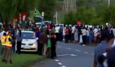 Mourners pay final respects to S. African leader, new details on memorial sign language interpreter.