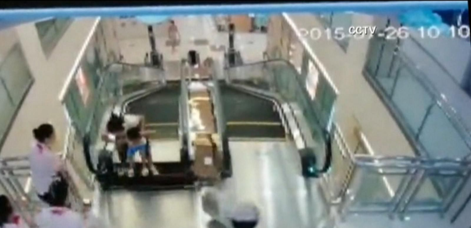 VIDEO: Chinese Woman Saves Child Before Dying in Escalator Accident