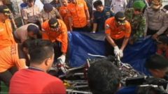 VIDEO: Divers have retrieved one of the black boxes from AirAsia Flight 8501 that crashed into the Java Sea two weeks ago.
