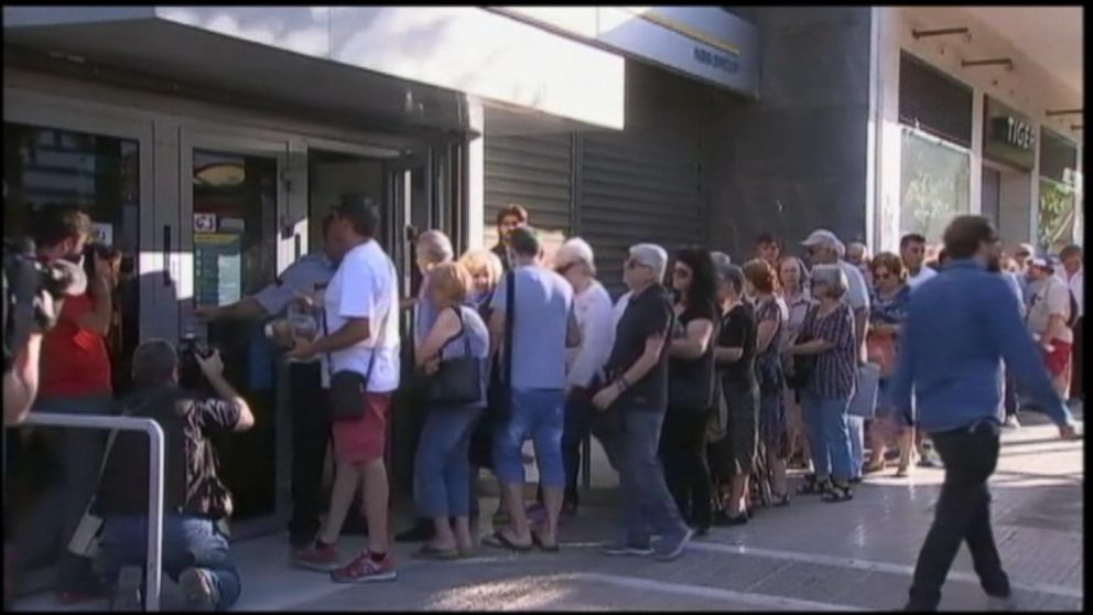 VIDEO: Restrictions on cash withdrawals remain in place however, as Greece also begins implementing new taxes on goods and services as part of negotiations for a bailout deal.