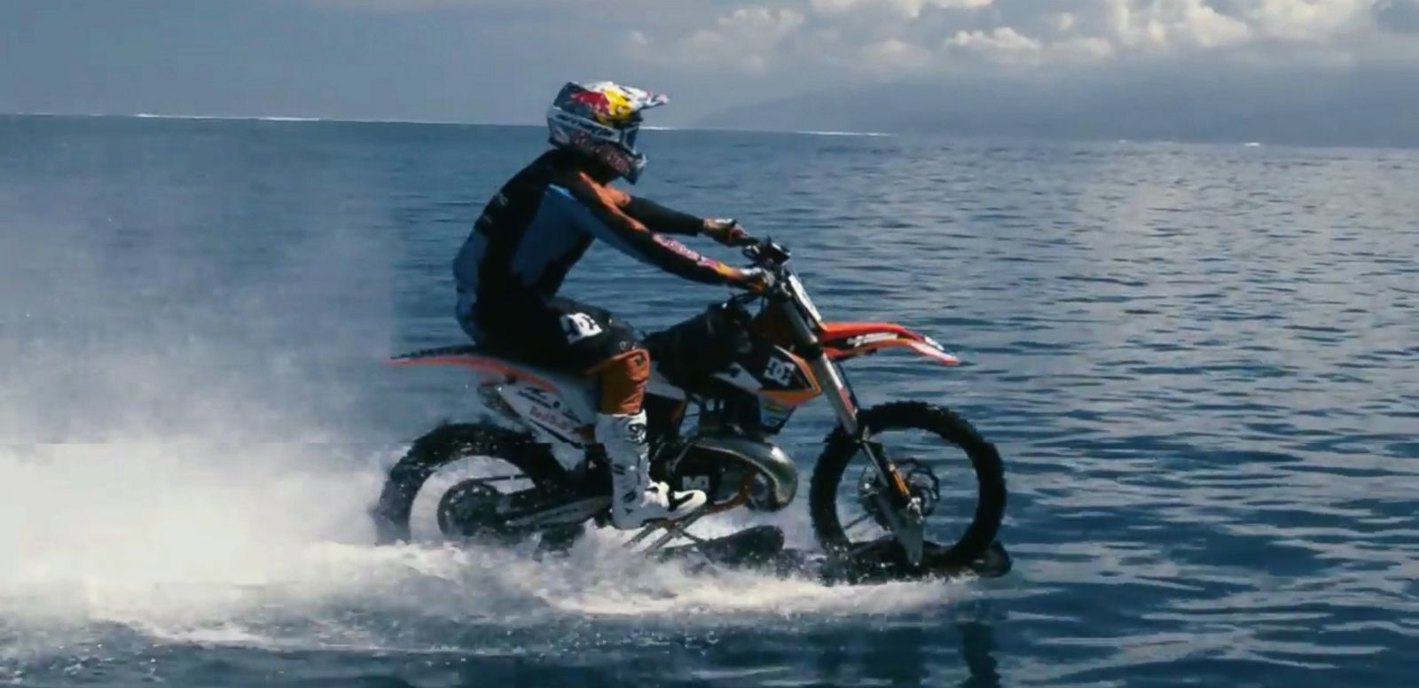 VIDEO: Robbie Maddison, an X-Games medalist, partnered with DC Shoes to create a modified dirt bike capable of riding across waves on Tahiti's shore.