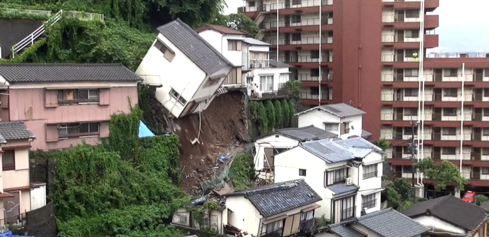 VIDEO: No injuries were reported after a house in the city of Nagasaki crashed atop other homes.