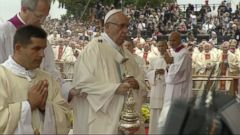 VIDEO: The 79-year-old pontiff fell to the ground after missing a step while approaching an open-air altar.