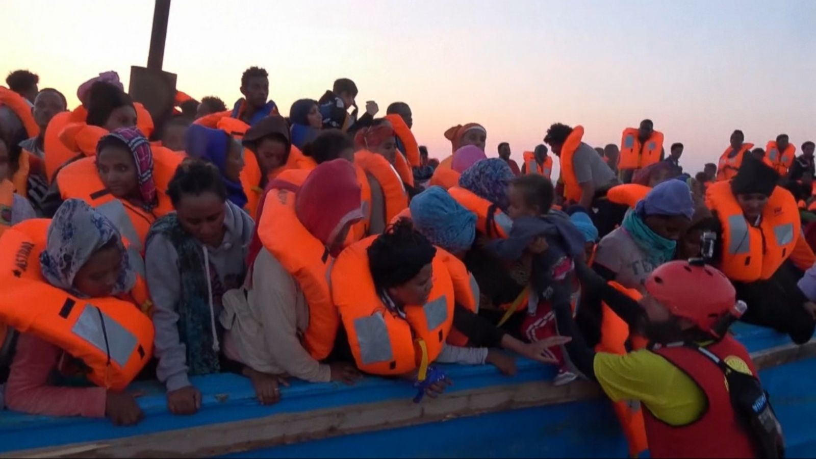 Thousands of refugees trying to reach Europe were rescued off the coast of Libya on Monday morning after their overcrowded wooden boats sent people falling into the Mediterranean Sea.