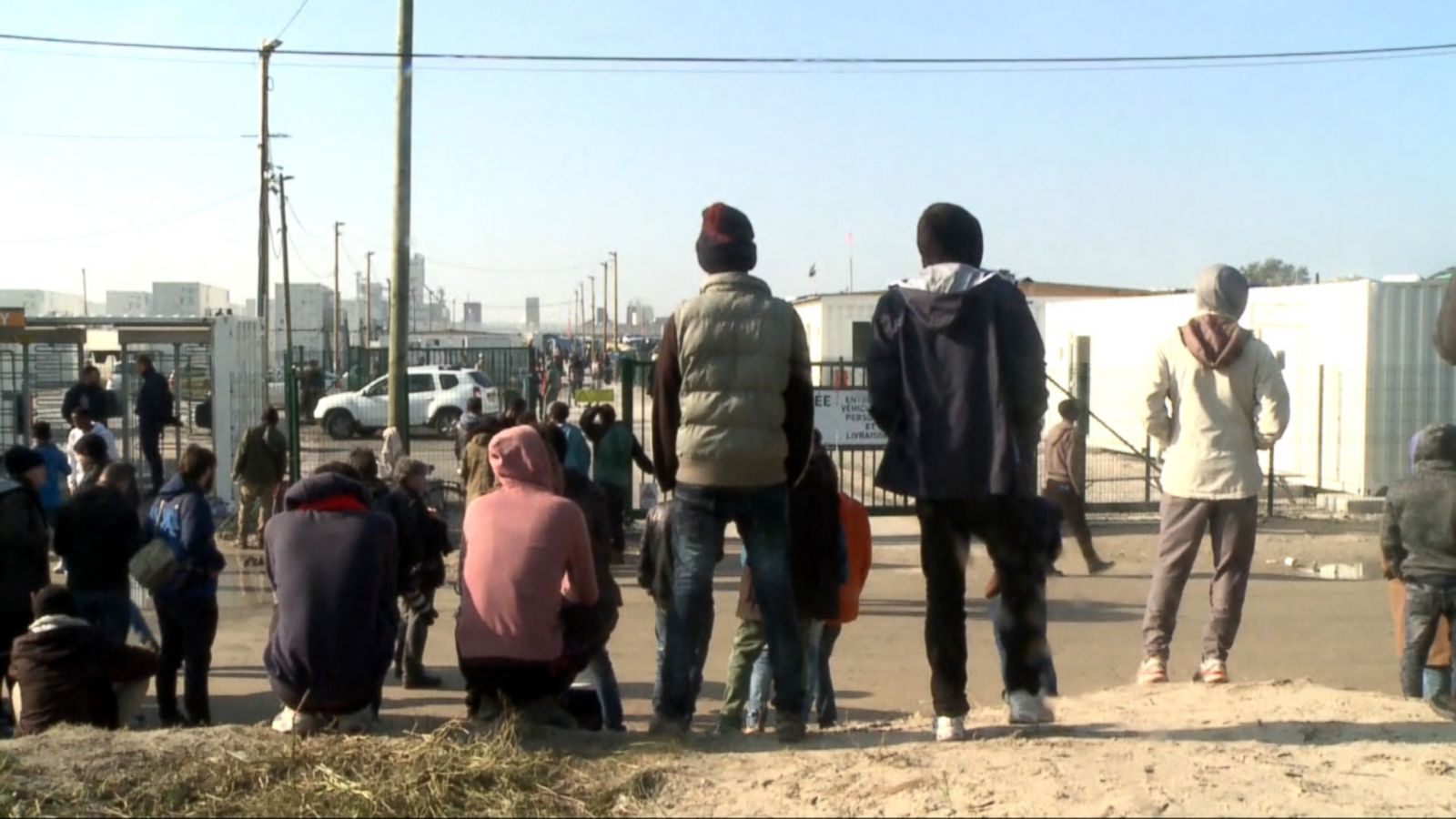 VIDEO: Lines of migrants with their lives in small bags waited calmly to get on buses in the French port city of Calais on Monday, the first day of the mass evacuation and destruction of the squalid camp they called home.