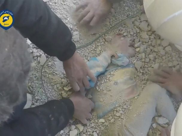 WATCH:  Child pulled alive from rubble after strikes in Syria