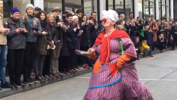 VIDEO: Flapjack-flipping relay racers run through London on