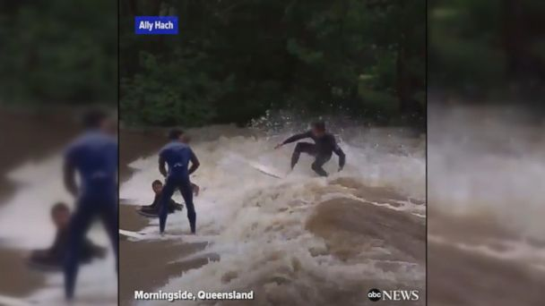 VIDEO: Australians surf and jet ski in raging floodwaters caused by Tropical Cyclone Debbie.