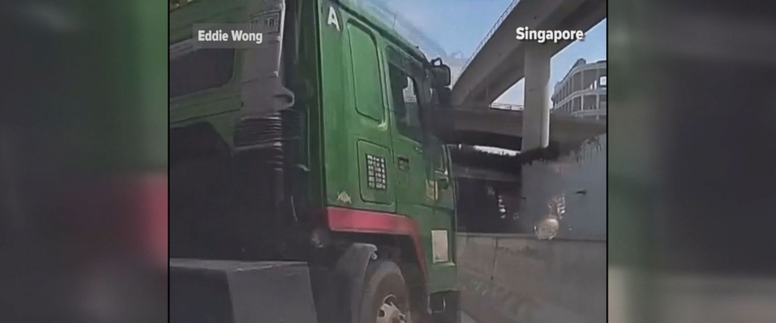 Dashcam captures moment truck veers into the path of a car, creating massive collision. The driver of the car escaped with bruised fingers.