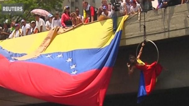 VIDEO:  Acrobat joins Venezuelans staging massive sit-in to protest government