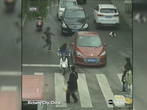 WATCH:  2-year-old survives being run over by 2 cars in China