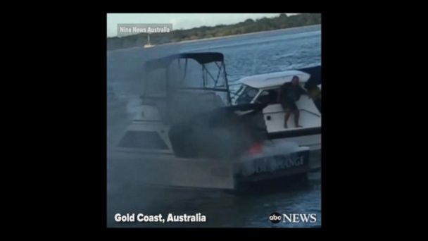 VIDEO: Father, son jump overboard after boat bursts into flames