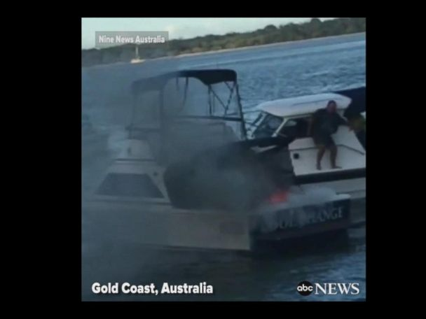 WATCH:  Father, son jump overboard after boat bursts into flames