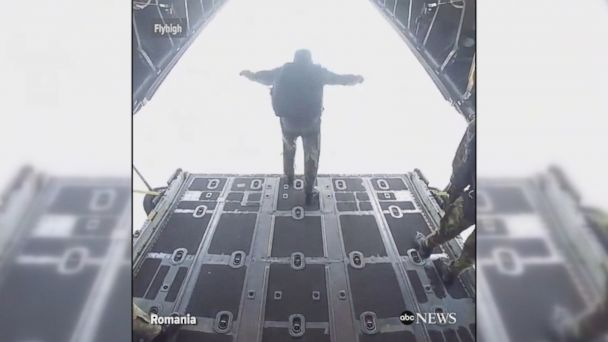 VIDEO: Paratrooper captures hair-raising footage during a training exercise of skydiving out of a military airplane over Romania.
