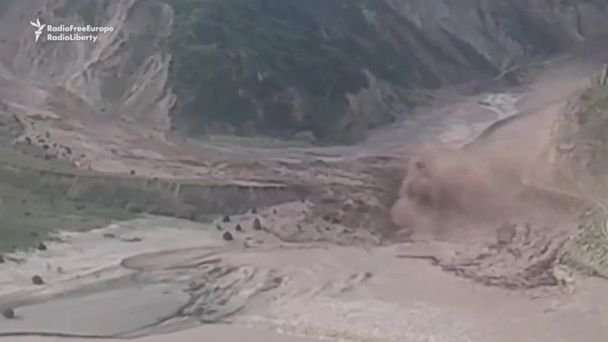 A massive landslide rolled through a valley in Tajikistan near the border to Kyrgyzstan today, partly blocking a road to the neighboring country.