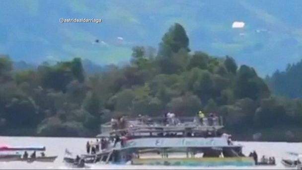 VIDEO: At least 6 people died when a boat carrying more than 150 passengers capsized while on a sightseeing tour on a reservoir in northwestern Colombia.