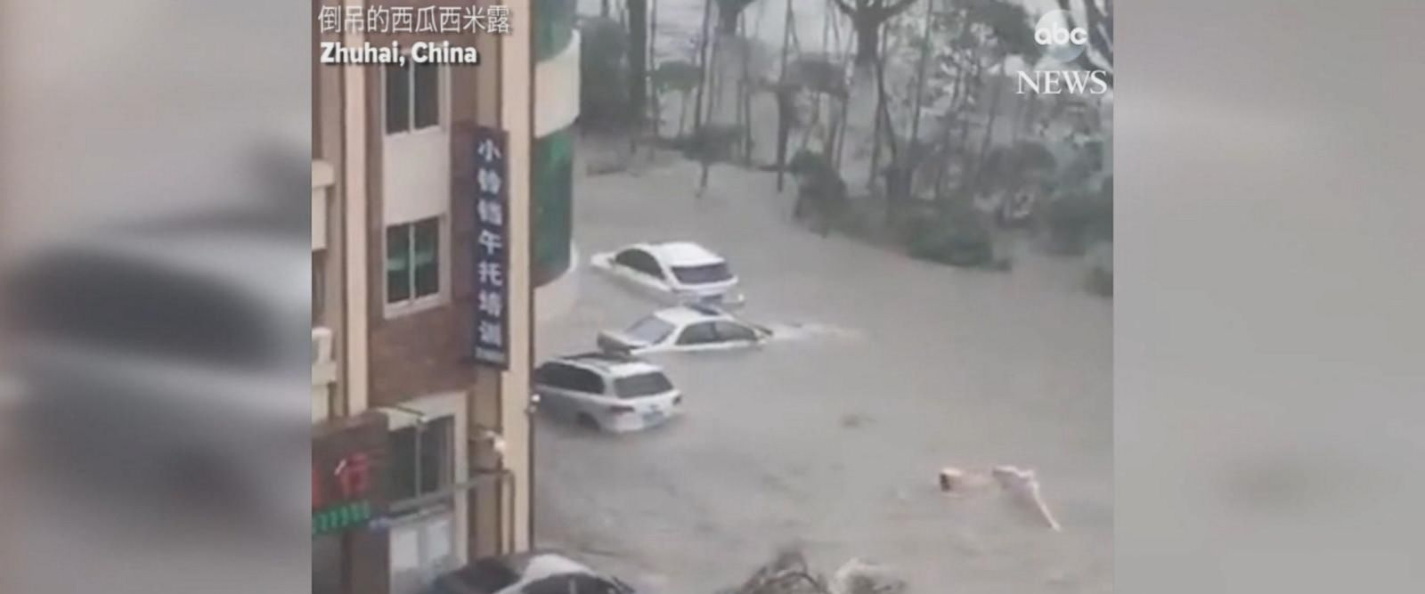 Video shows cars floating in flooded streets, with waves and wind slamming the shoreline.