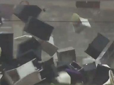 WATCH:  Gusts send outdoor furniture flying