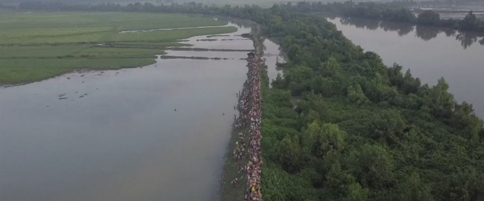 Aerial footage released by the United Nations High Commissioner for Refugees showed the exodus of refugees, with thousands of people seen carrying their belongings on foot along narrow paths flanked by rivers.