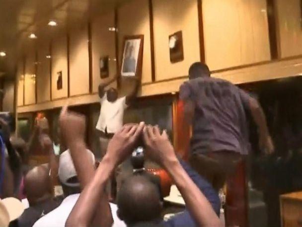 WATCH:  Zimbabweans tear down portrait of Mugabe