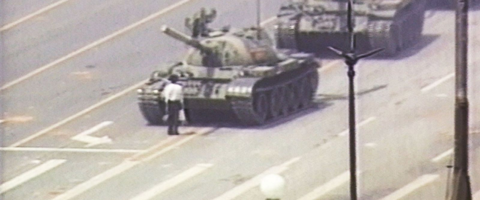 PHOTO: A lone demonstrator stands down a column of tanks June 5, 1989 at the entrance to Tiananmen Square in Beijing.