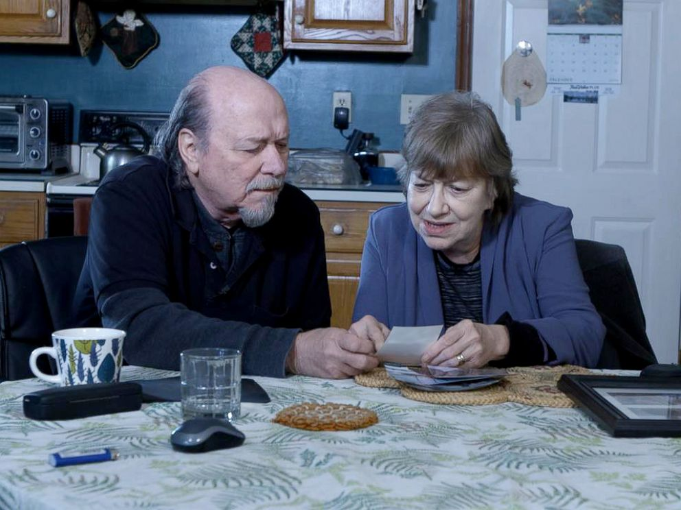 PHOTO: Jim and Lyn Coleman review old photos as they prepare for a fifth Christmas without their daughter and her family, who are being held by the Taliban.