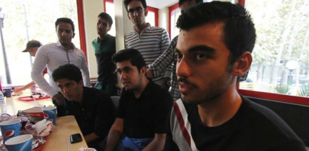 PHOTO: Students from Teheran share their thoughts with Muhammad Lila.