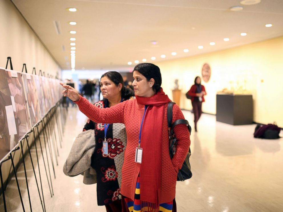 PHOTO: A viewer looks on at the Caesar photo exhibition at the United Nations Headquarters in New York, March 13, 2015.