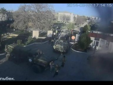 Russian Forces Storm Ukrainian Airbase in Crimea