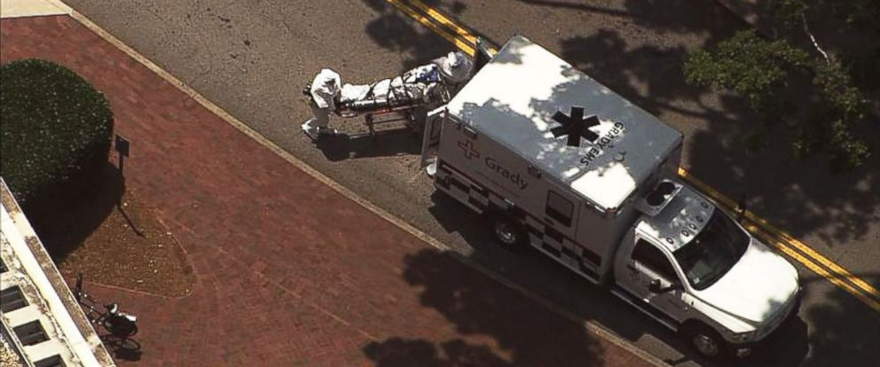PHOTO: Nancy Writebol, 59, was seen being wheeled in on a stretcher when she arrived at Emory University Hospital in Atlanta on Aug. 5, 2014.
