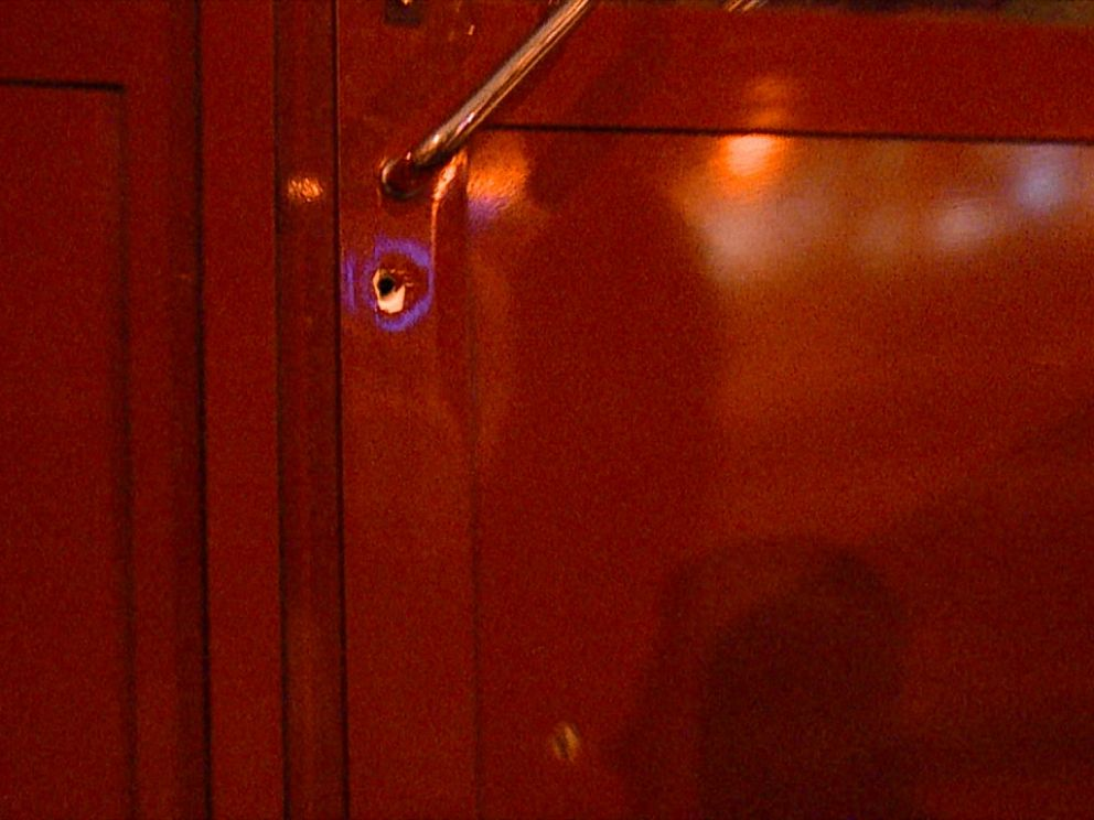 Bullet holes left in the front door of Central Station after an armed attack in November.