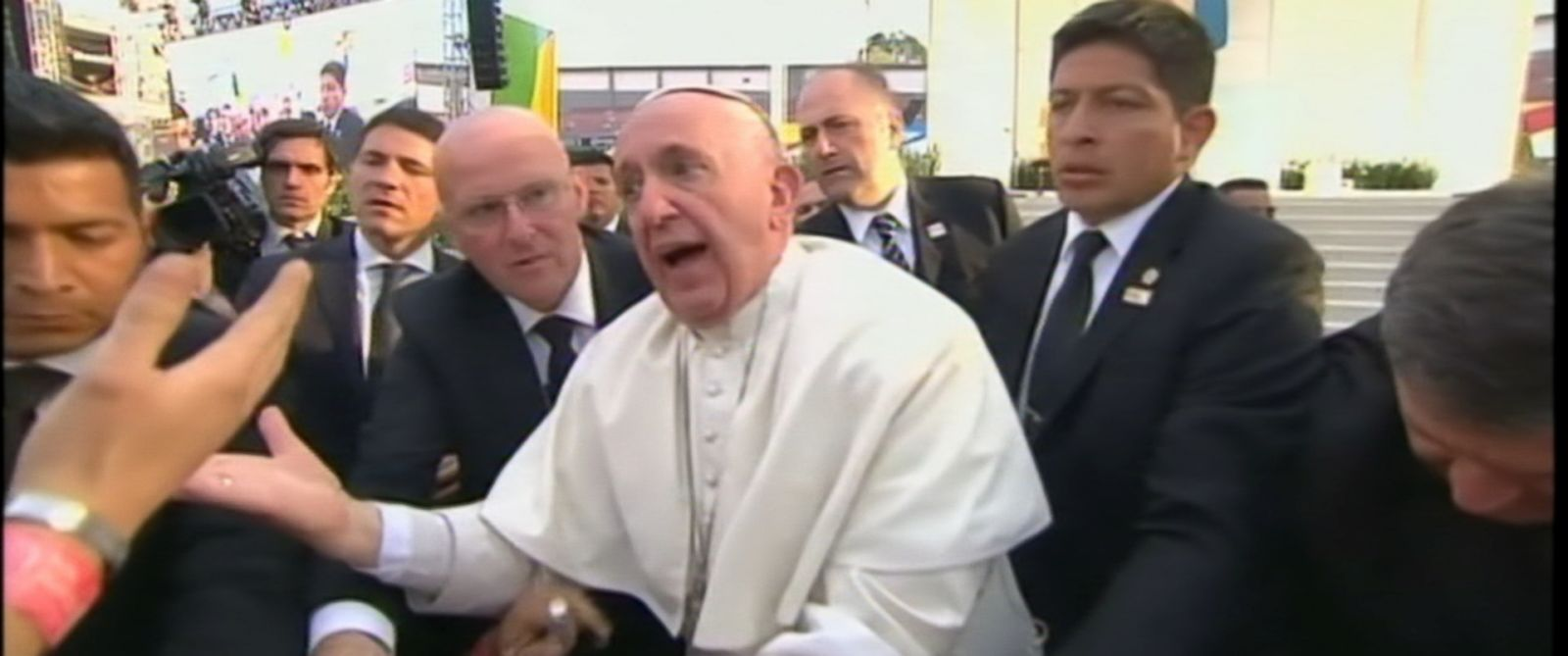 PHOTO: The pontiff almost fell over as crowds tugged on his sleeve during a stop in Mexico.