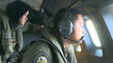 PHOTO: Members of a search planes flight crew scan for evidence of the missing Malaysia Airlines flight #MH370.