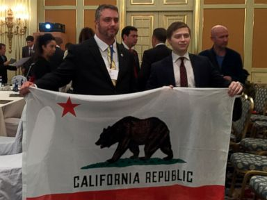 PHOTO: Louis J. Marinelli, president of the YES California Independence Campaign holds a flag for his proposed independent Californian republic at a conference of separatist groups in Moscows Ritz Hotel, across the street from the Kremlin.