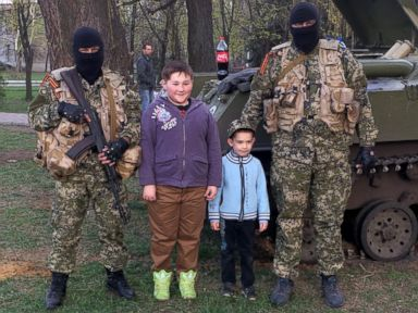 Ukrainian Children Smile and Pose With Pro-Russian Forces