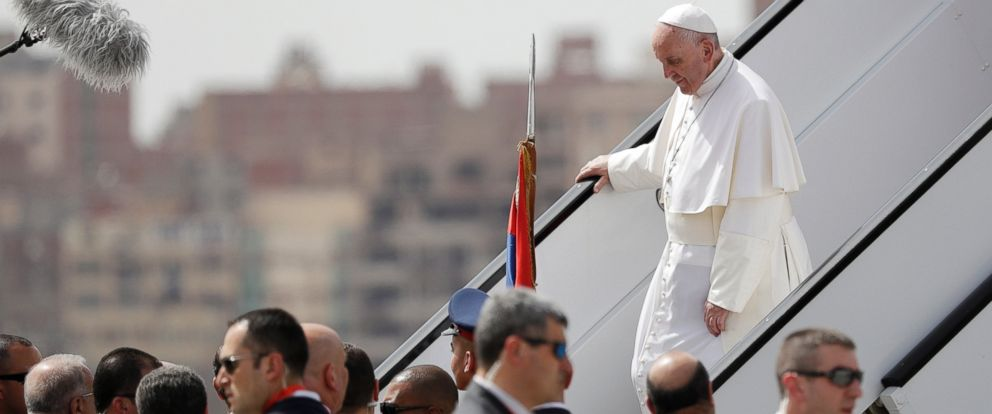 PHOTO: Pope Francis walks down the steps of an airplane upon arriving at Cairos airport, Egypt, on April 28, 2017.