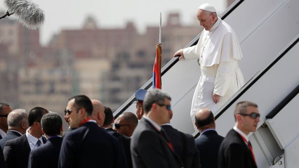 PHOTO: Pope Francis walks down the steps of an airplane upon arriving at Cairo's airport, Egypt, on April 28, 2017.