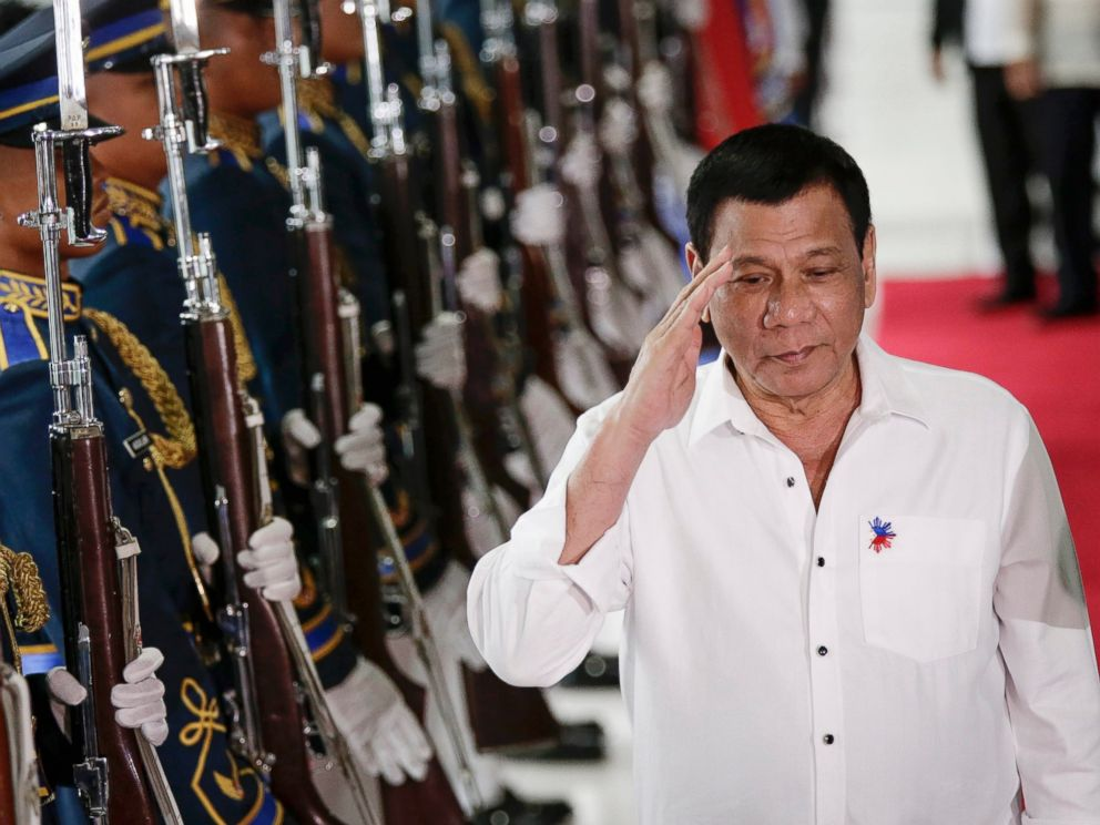 PHOTO: Philippine President Rodrigo Duterte reviews honor guards during a departure ceremony at the Manila International Airport in Pasay City, south of Manila, Philippines, Dec. 13, 2016.