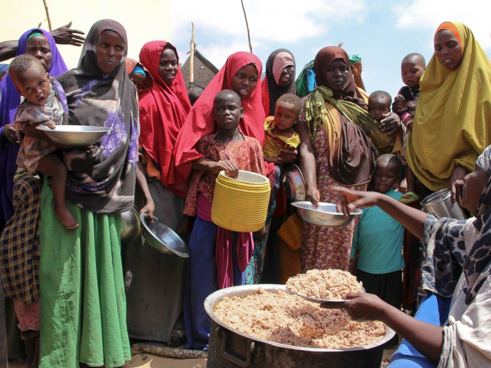 PHOTO: Newly arrived Somalis, displaced by the drought, receive food distributions at makeshift camps in the Tabelaha area on the outskirts of Mogadishu, Somalia, on March 30, 2017.