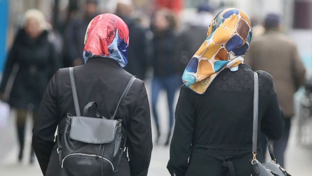 PHOTO: In this  April 21, 2017 photo women with head scarfs are walking in a pedestrian zone in Vienna, Austria.