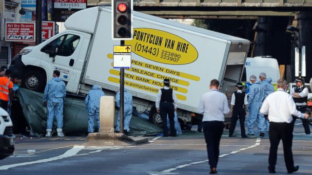 PHOTO: Forensic officers move the van at Finsbury Park in north London, where a vehicle struck pedestrians in north London, June 19, 2017.