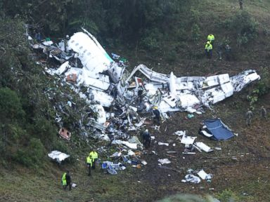 PHOTO:Police officers and rescue workers search for survivors around the wreckage of a chartered airplane that crashed in La Union, a mountainous area outside Medellin, Colombia, Nov. 29 2016.