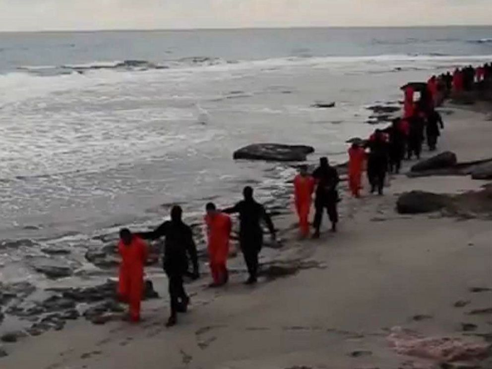 PHOTO: This file image made from a video released Feb. 15, 2015 by militants in Libya claiming loyalty to the Islamic State group purportedly shows Egyptian Coptic Christians in jumpsuits being led along a beach, each accompanied by a masked militant.