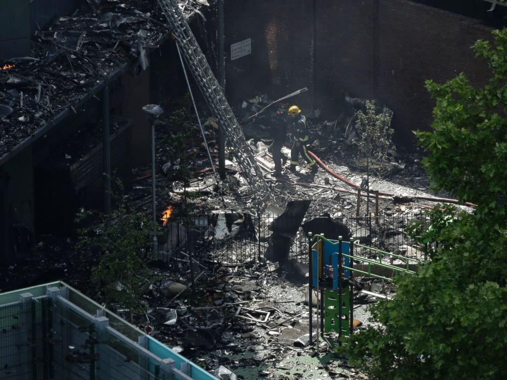 PHOTO: Firefighters battle a massive fire that raged in a high-rise apartment building in London, June 14, 2017.