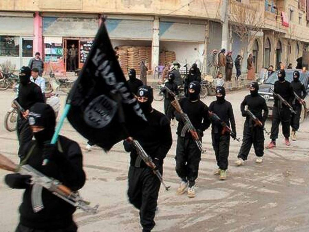 PHOTO: This undated file image posted on a militant website on Jan. 14, 2014, which has been verified and is consistent with other AP reporting, shows fighters from the al-Qaida linked Islamic State of Iraq and the Levant (ISIL) in Raqqa, Syria. <p itemprop=