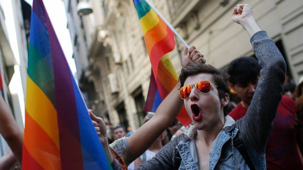 PHOTO: Participants of a Pride Week event in Istanbul chant slogans after police used a water canon to disperse them, in this June 28, 2015 file photo.