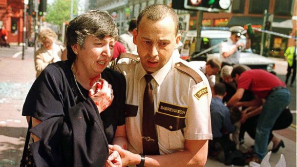 PHOTO: An injured woman is helped from the scene of a bomb blast in central Manchester, England, June 15, 1996.