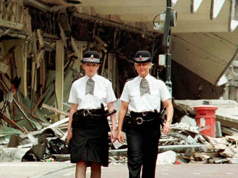 PHOTO: Manchester Police Officers Vanessa Winstanley and Wendy McCormick patrol outside the destroyed Marks and Spencers building in central Manchester, England,June 18, 1996.